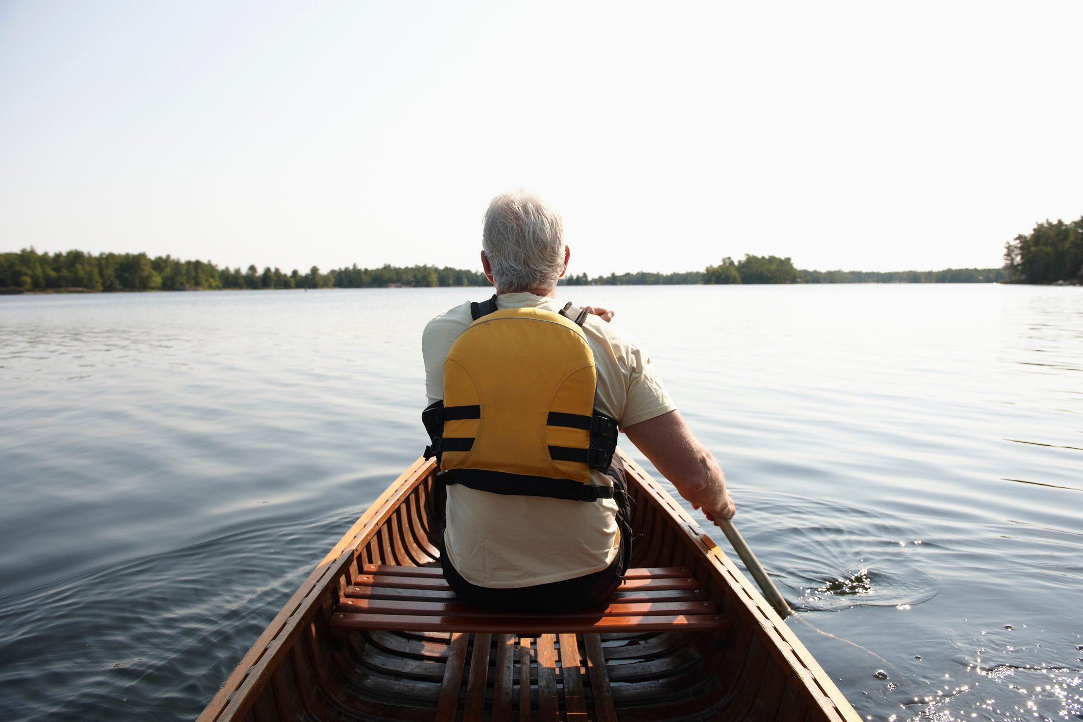 Man Paddling Canoe, Backview