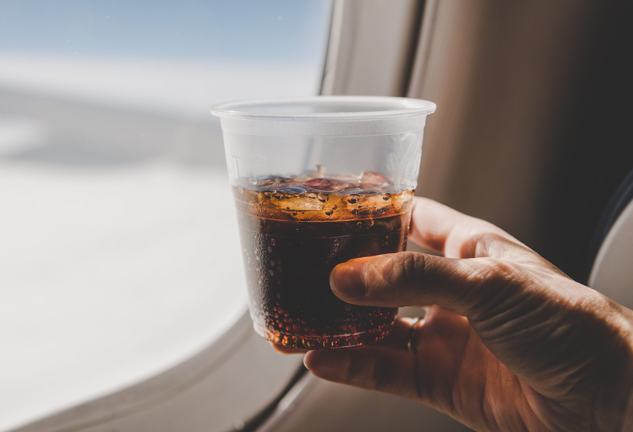 Drinking Glass By Airplane Window
