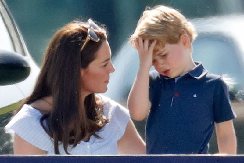 Catherine, Duchess of Cambridge comforts Prince George of Cambridge as they attend the Maserati Royal Charity Polo Trophy at the Beaufort Polo Club on June 10, 2018 in Gloucester, England.