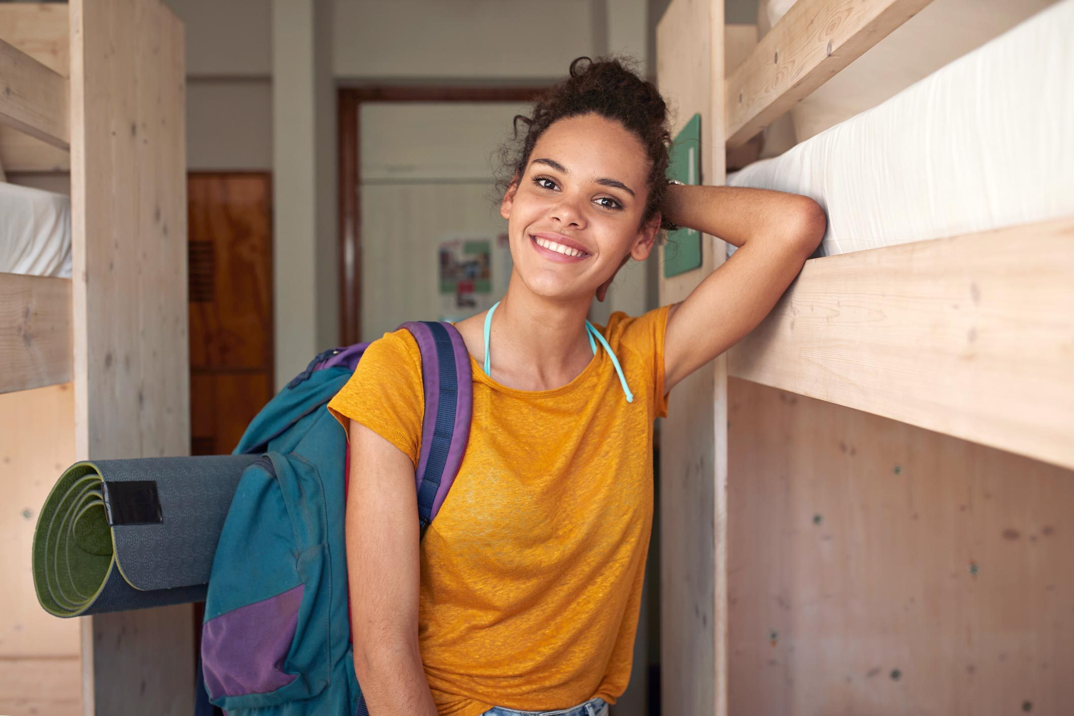 Portrait of young smiling woman at youth hostel