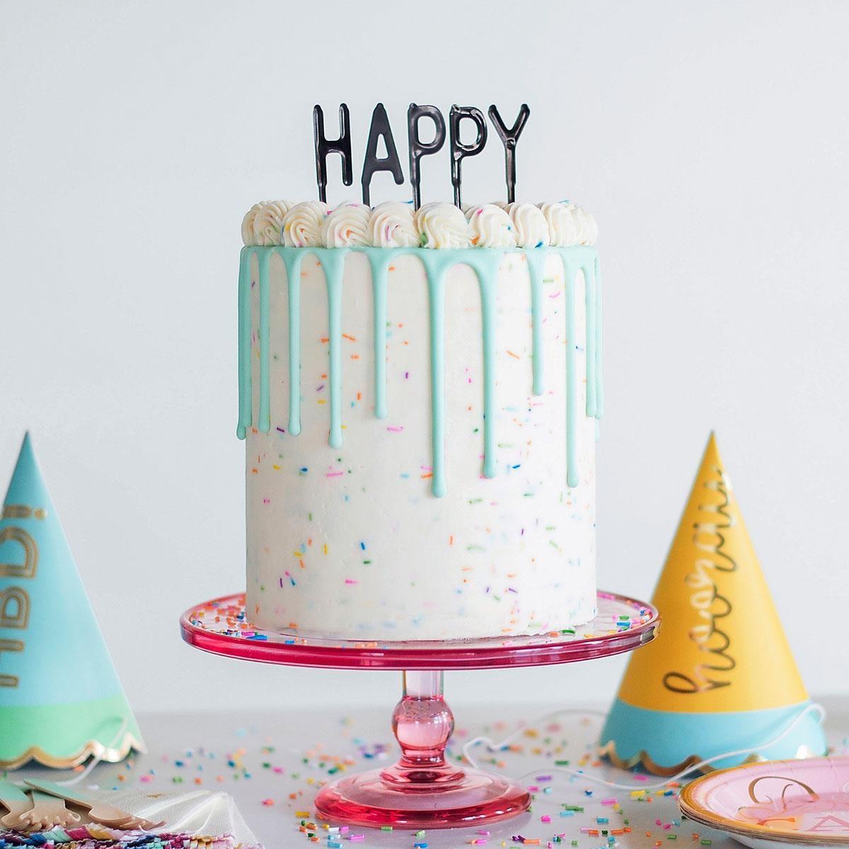confetti birthday cake with drip icing