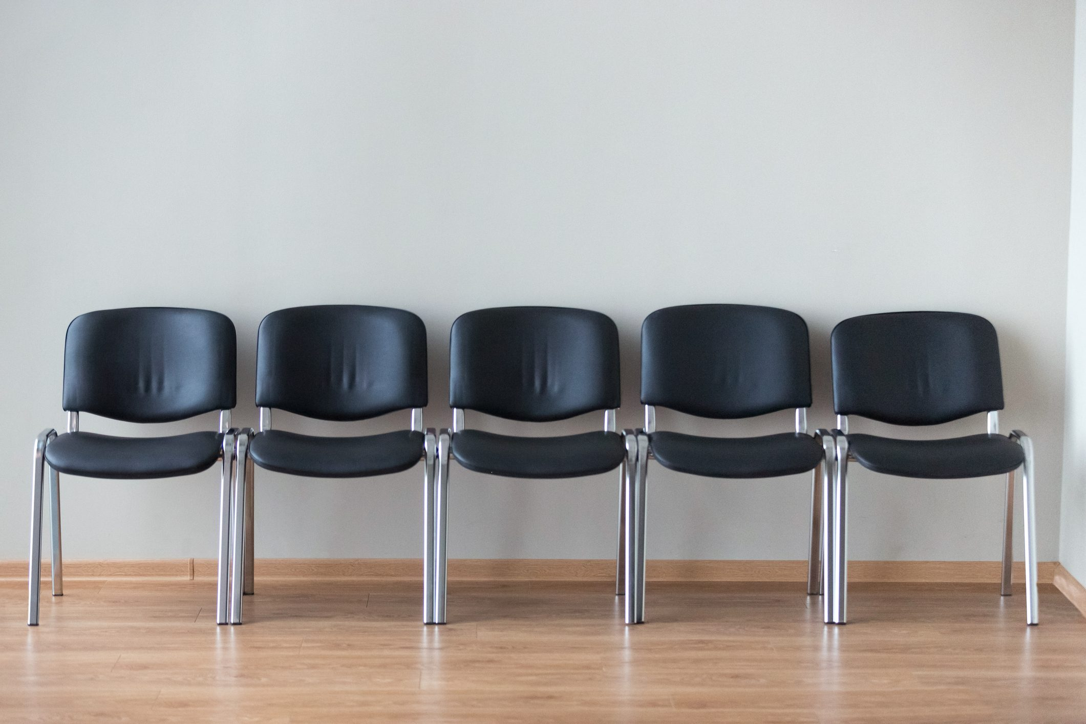 Row of black office chairs in conference room