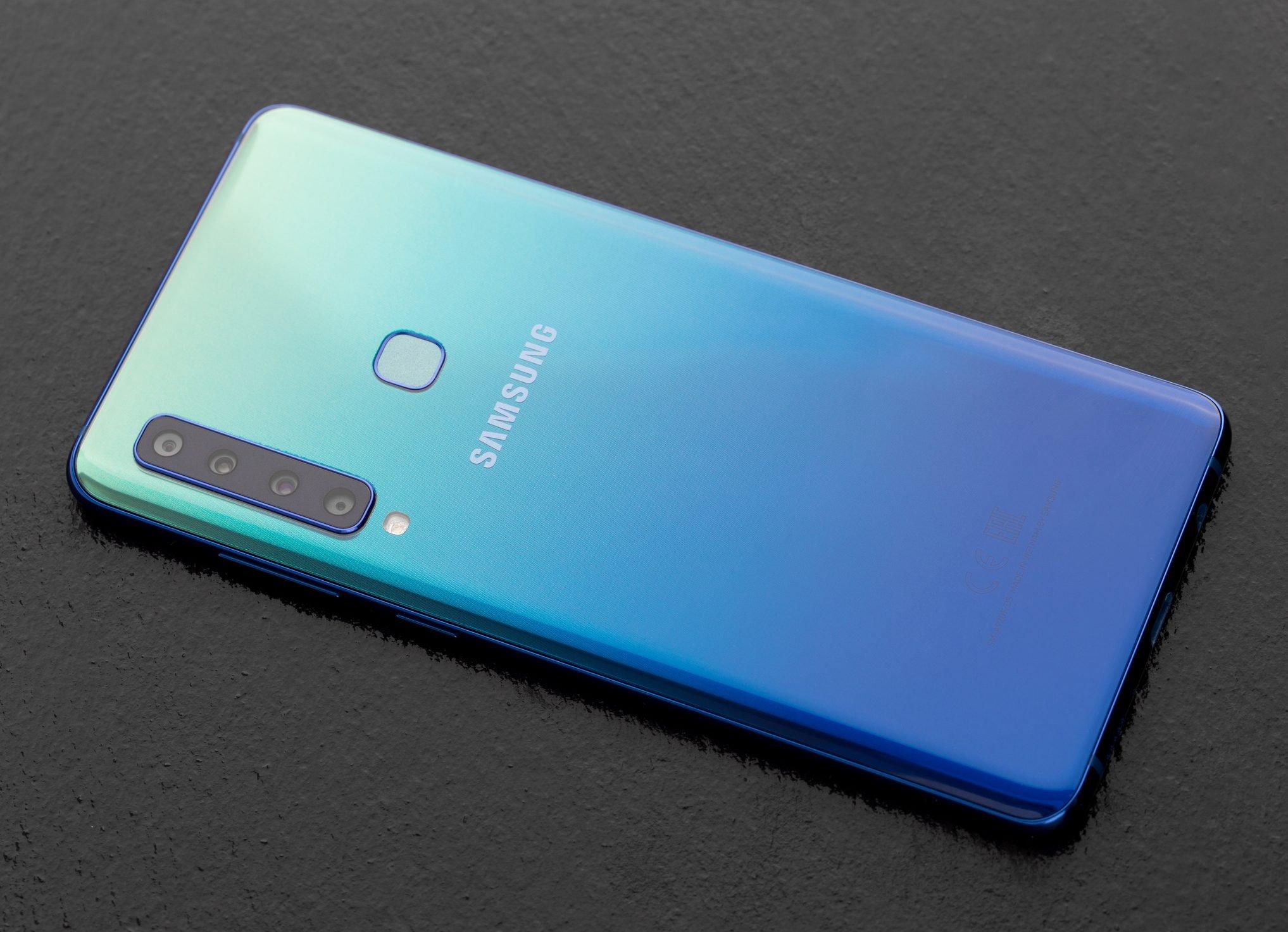 Samsung Galaxy A9 on slate surface.