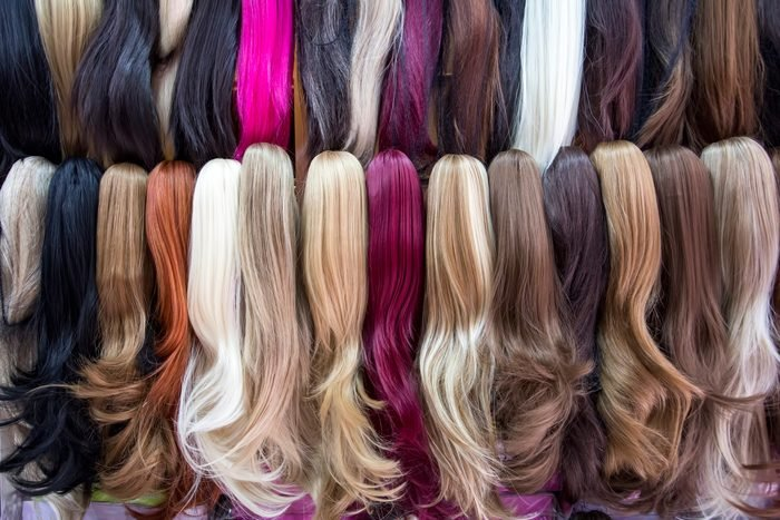 Different color human hair extensions in wig shop
