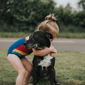 Girl hugs Dog