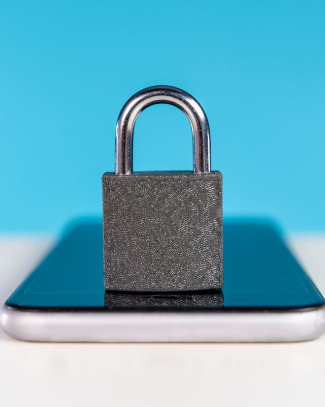 Locked padlock on mobile phone