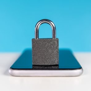 Locked padlock on mobile phone