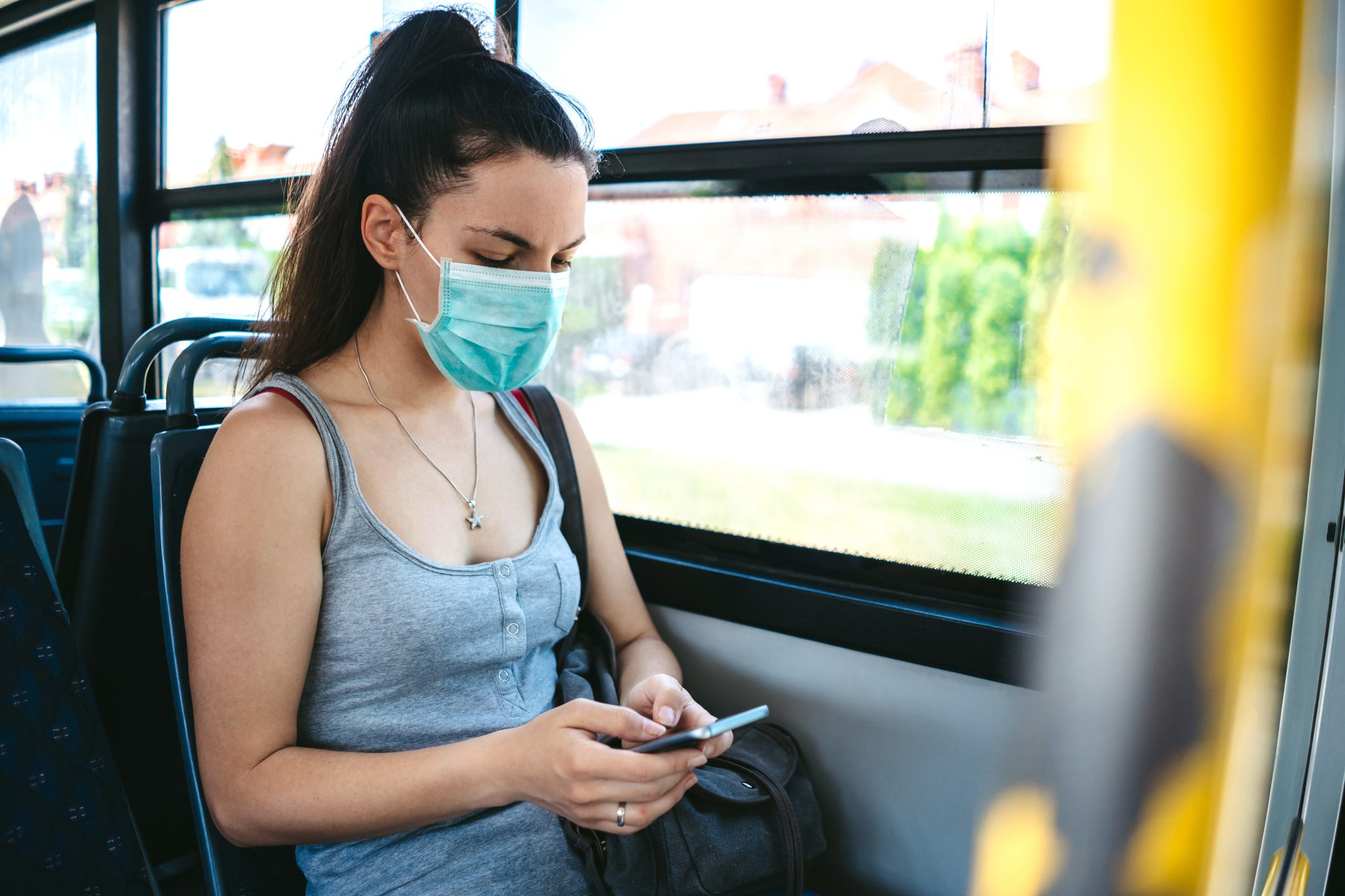 Woman with mask in bus