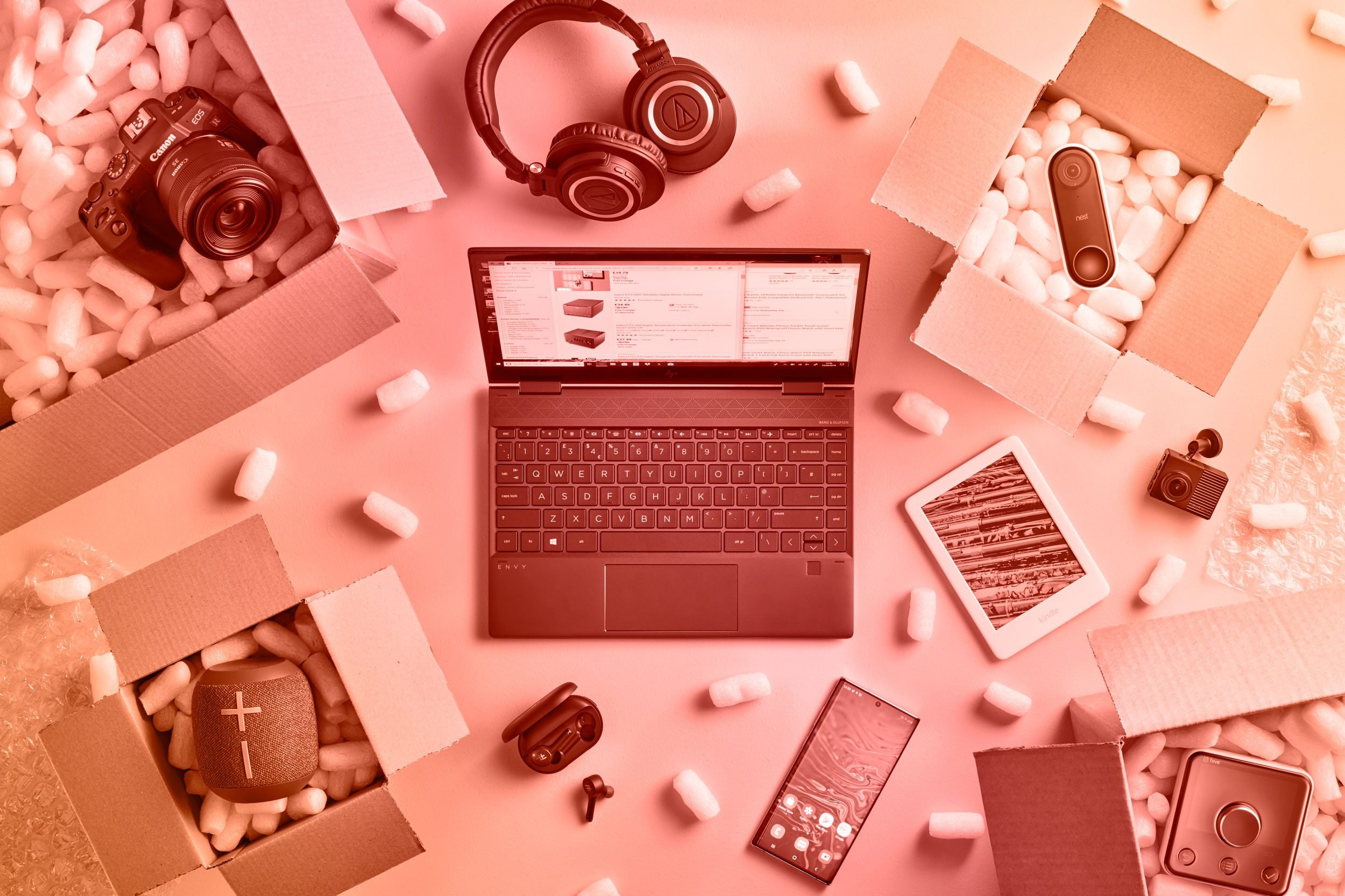 electronics and cardboard boxes with packing peanuts; overhead view