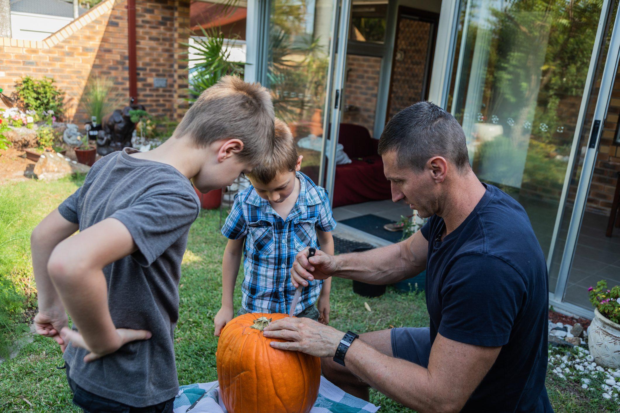 Family carving a Halloween Pumpkin
