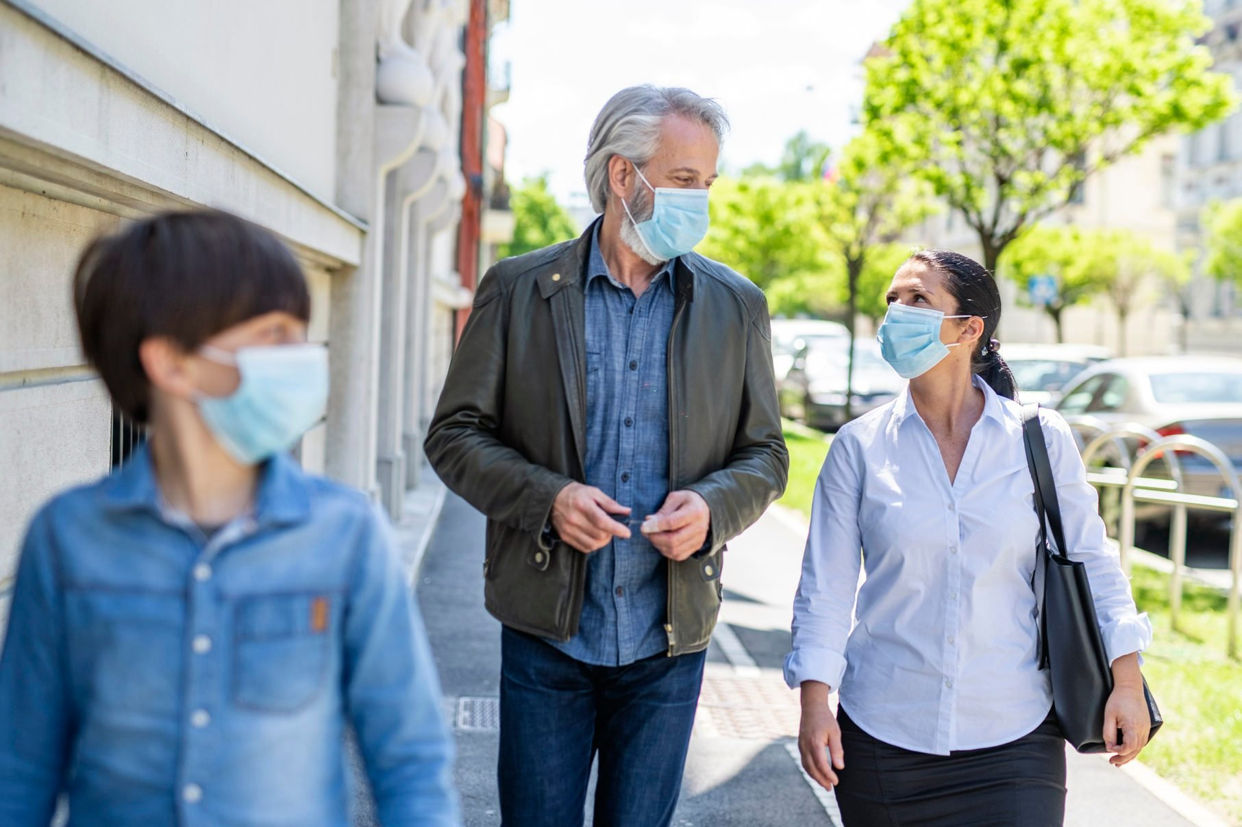Family of Three Wearing Masks Outdoors During 2020 Pandemic