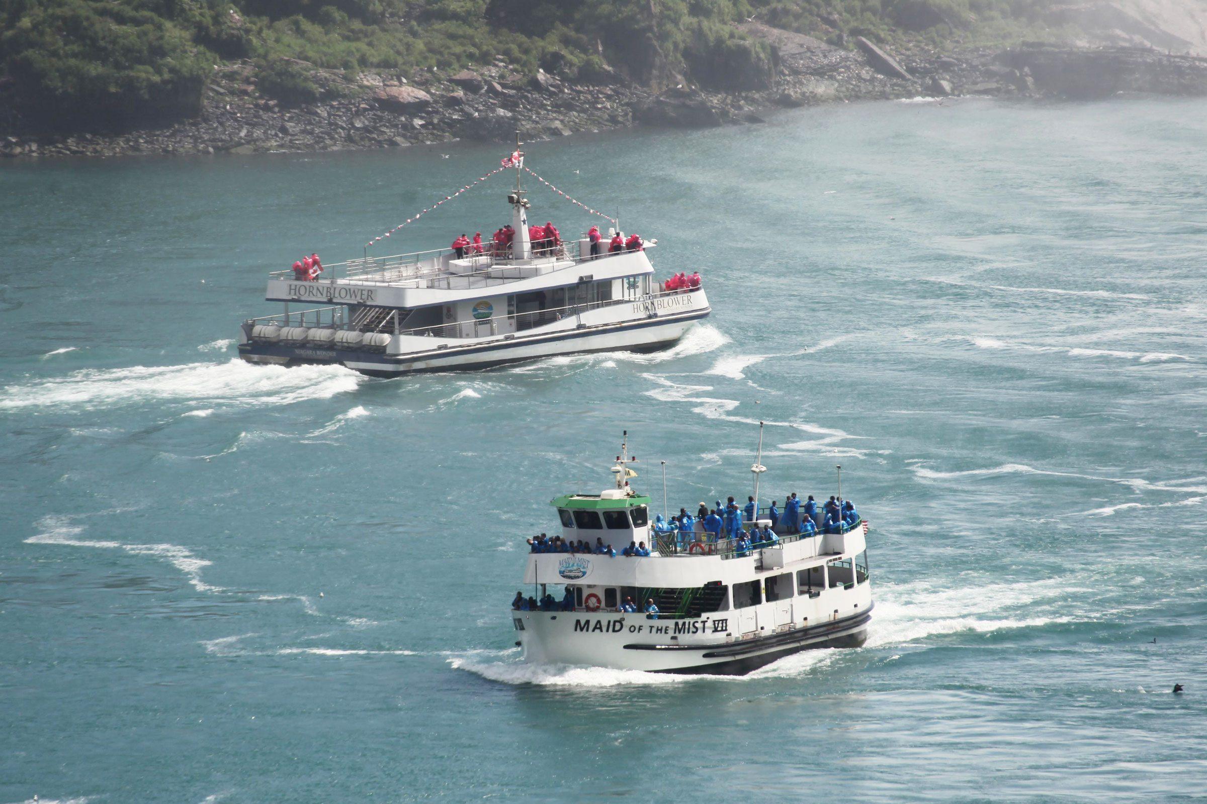 a US boat and a Canadian boat at Niagara Falls
