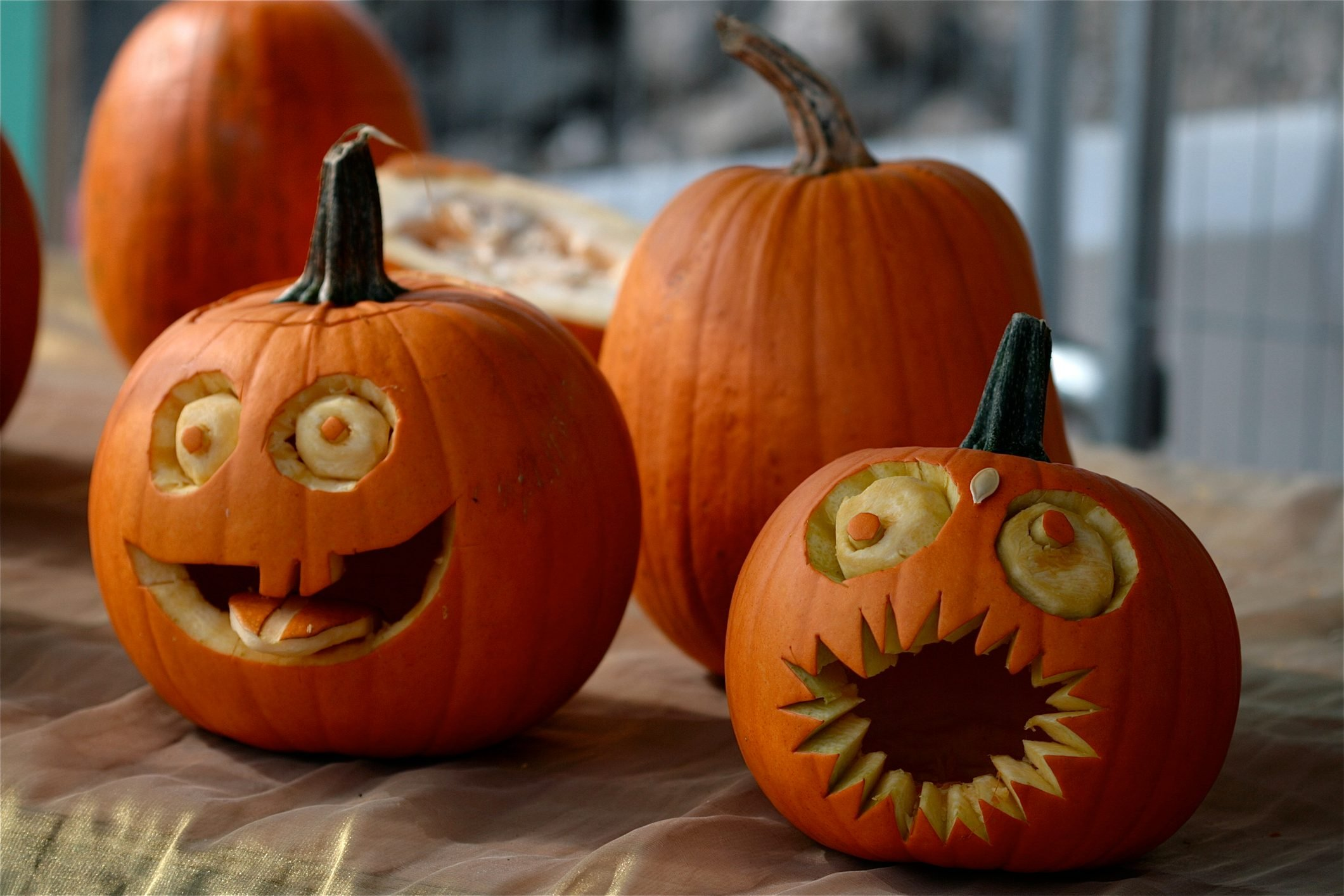 Pumpkins decorated with faces with eyes and mouths