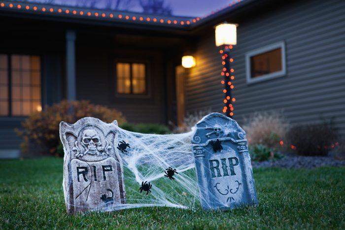 USA, Illinois, Metamora, Halloween gravestone decoration on lawn