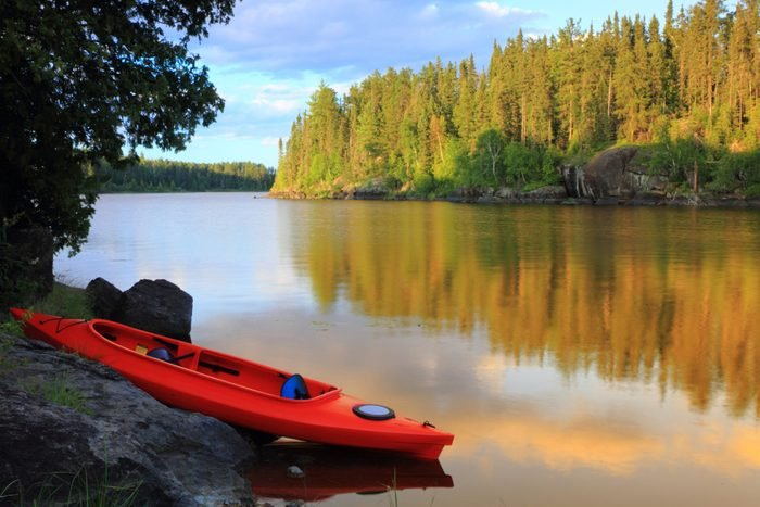 A red and blue canoe at the lake on a lovely day