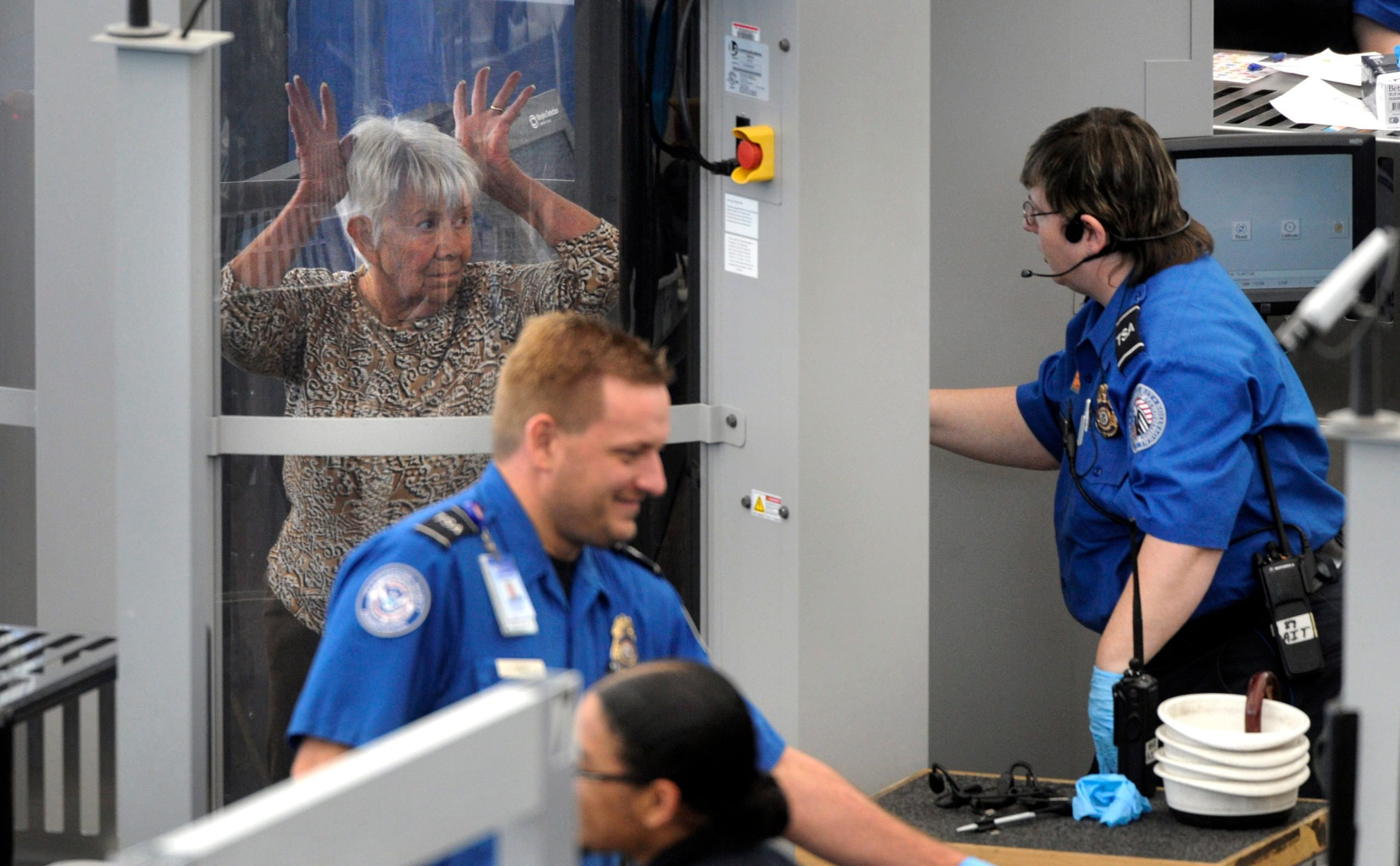 111710_PATDOWN_CFW- A woman gets instruction from a Transportation Security Administration agent while passing through a full body scanner at Denver International Airport in Denver, CO, November 17, 2010. (Craig F. Walker/ The Denver Post)