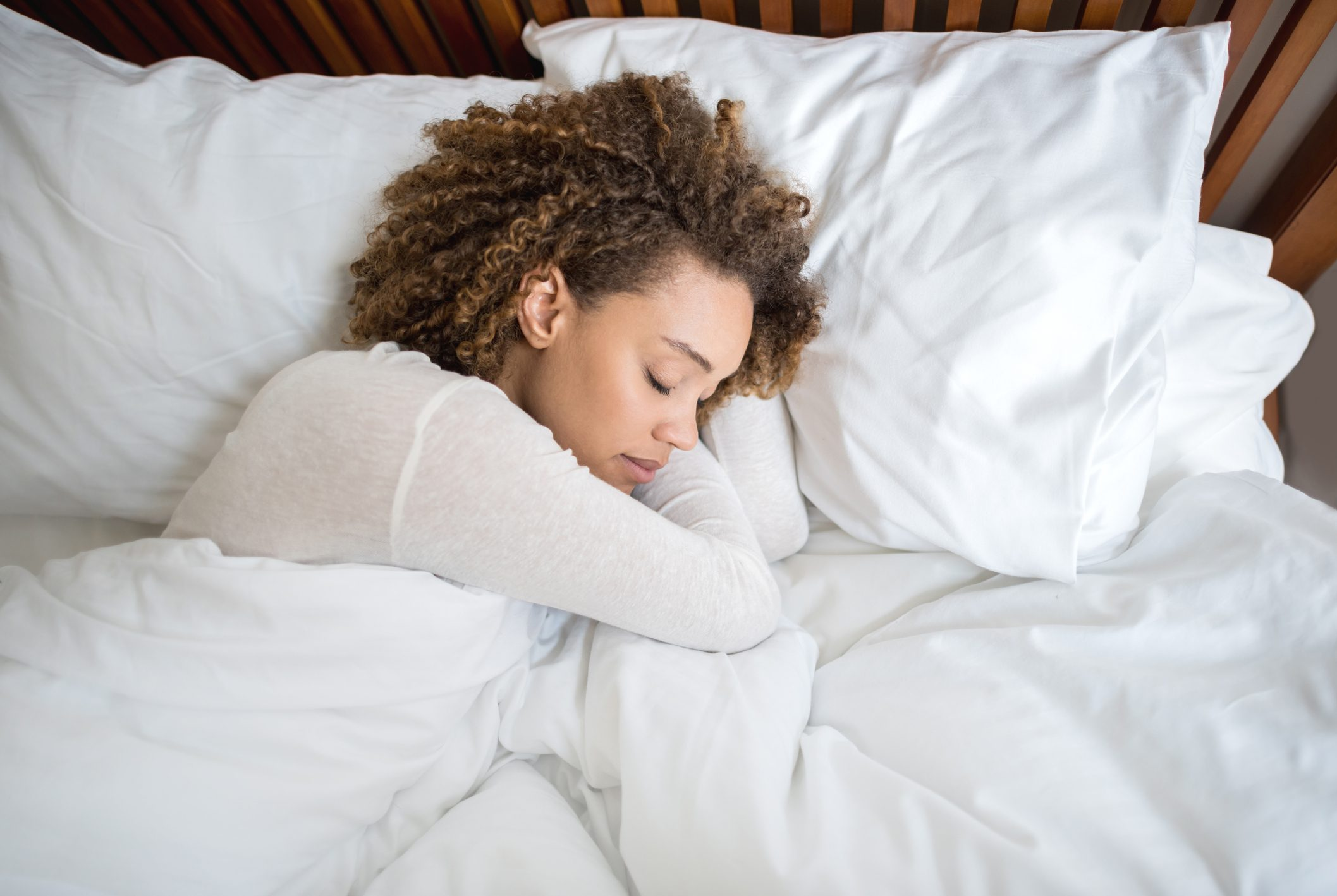 African American woman sleeping in bed
