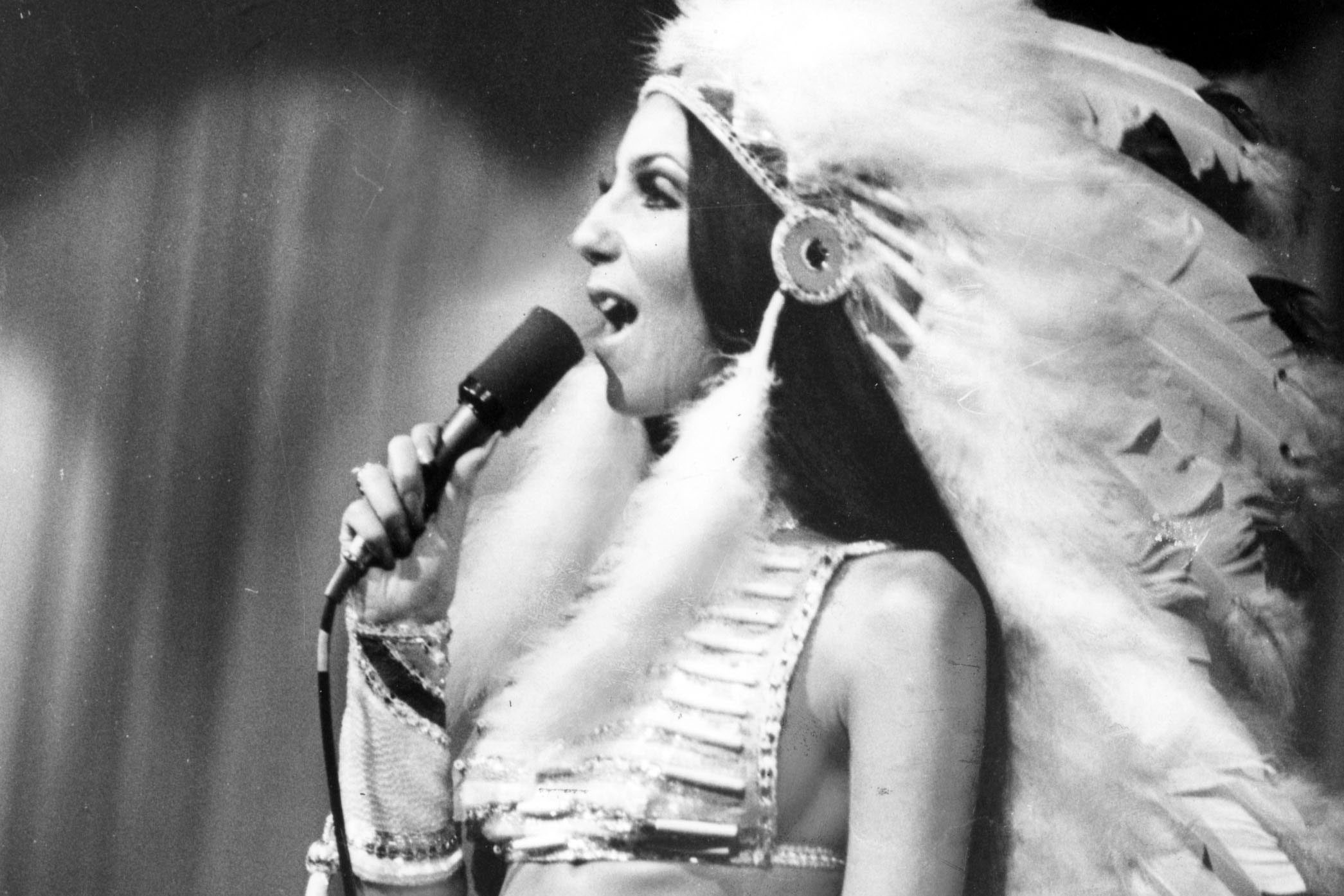 cher on stage in native american outfit