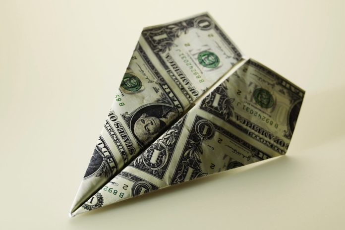 Paper Airplane Made of American Currency