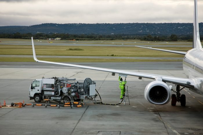 An airplane being refueled on the tarmac