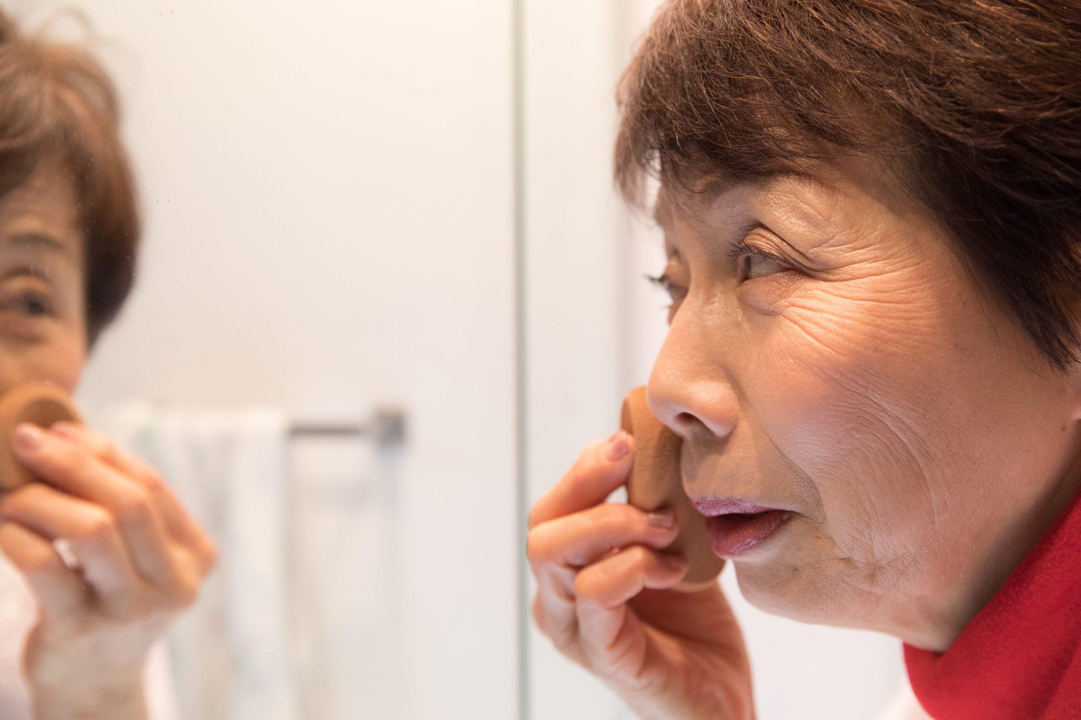 Japanese senior woman putting make up