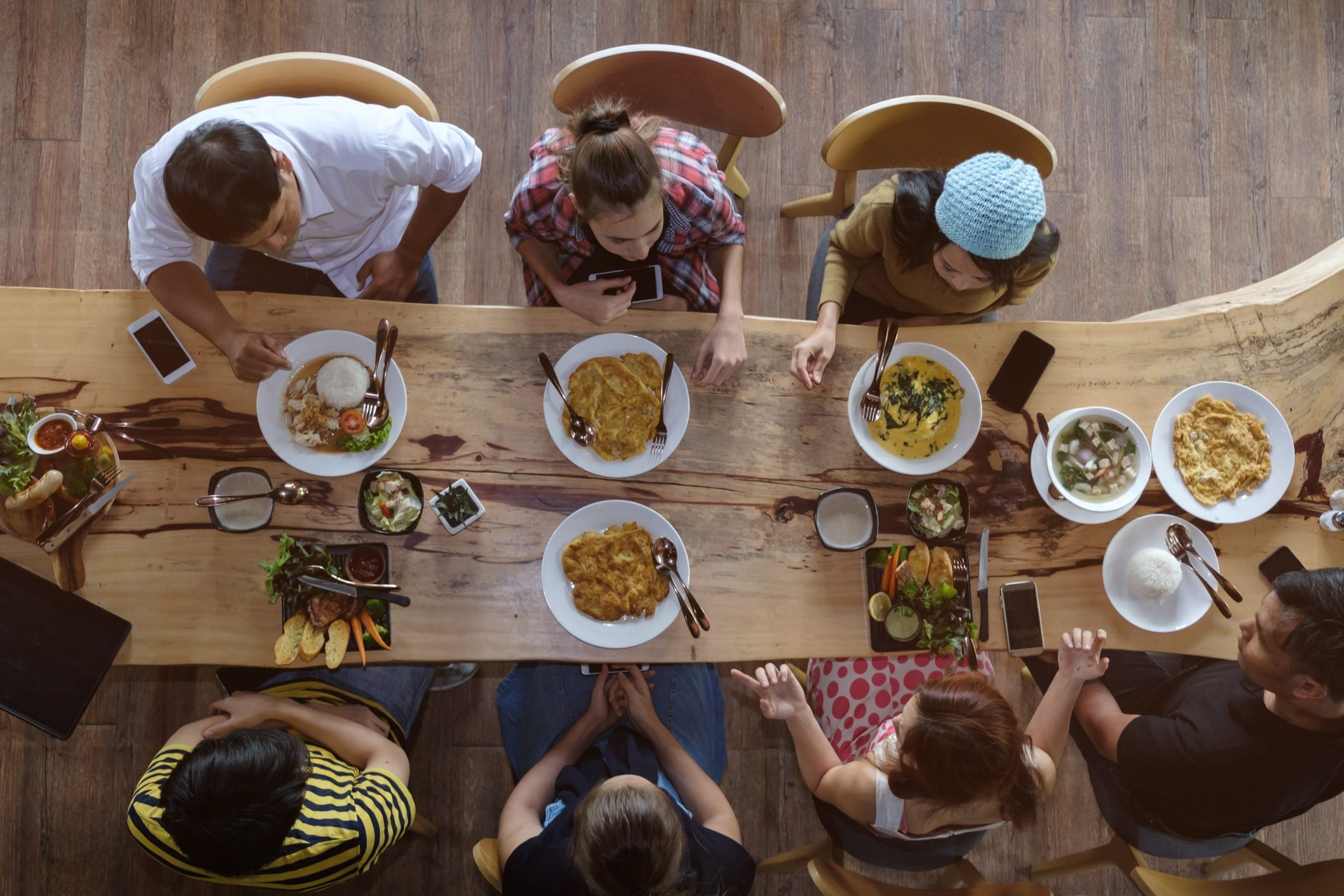 Directly Above Shot Of Friends Having Food On Restaurant Table
