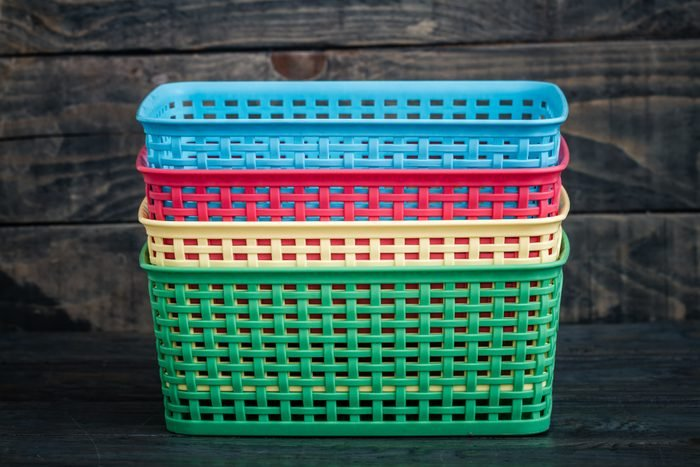 Colorful Mini Plastic Cases on Blue Background