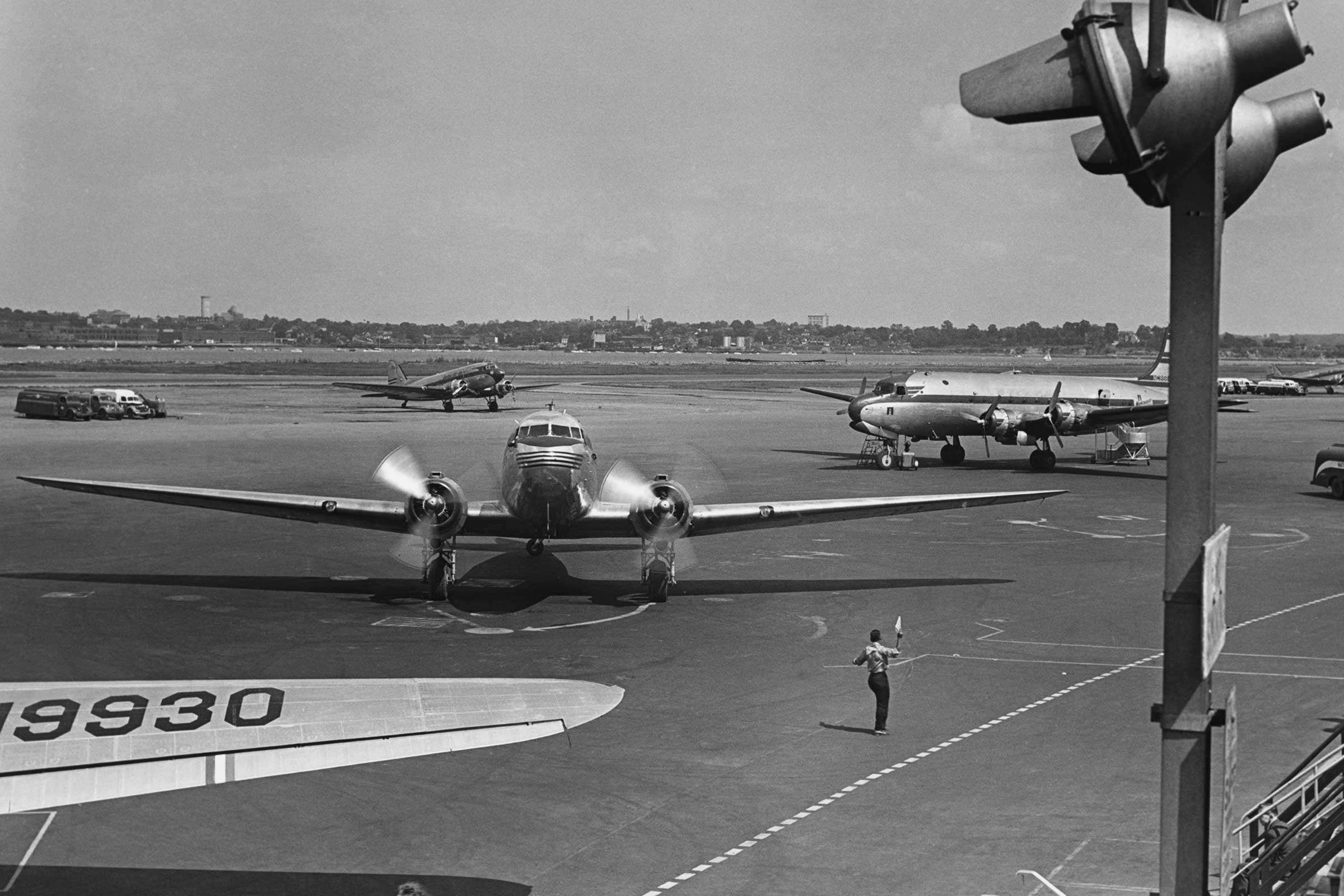 Planes on runway, (B&W), elevated view