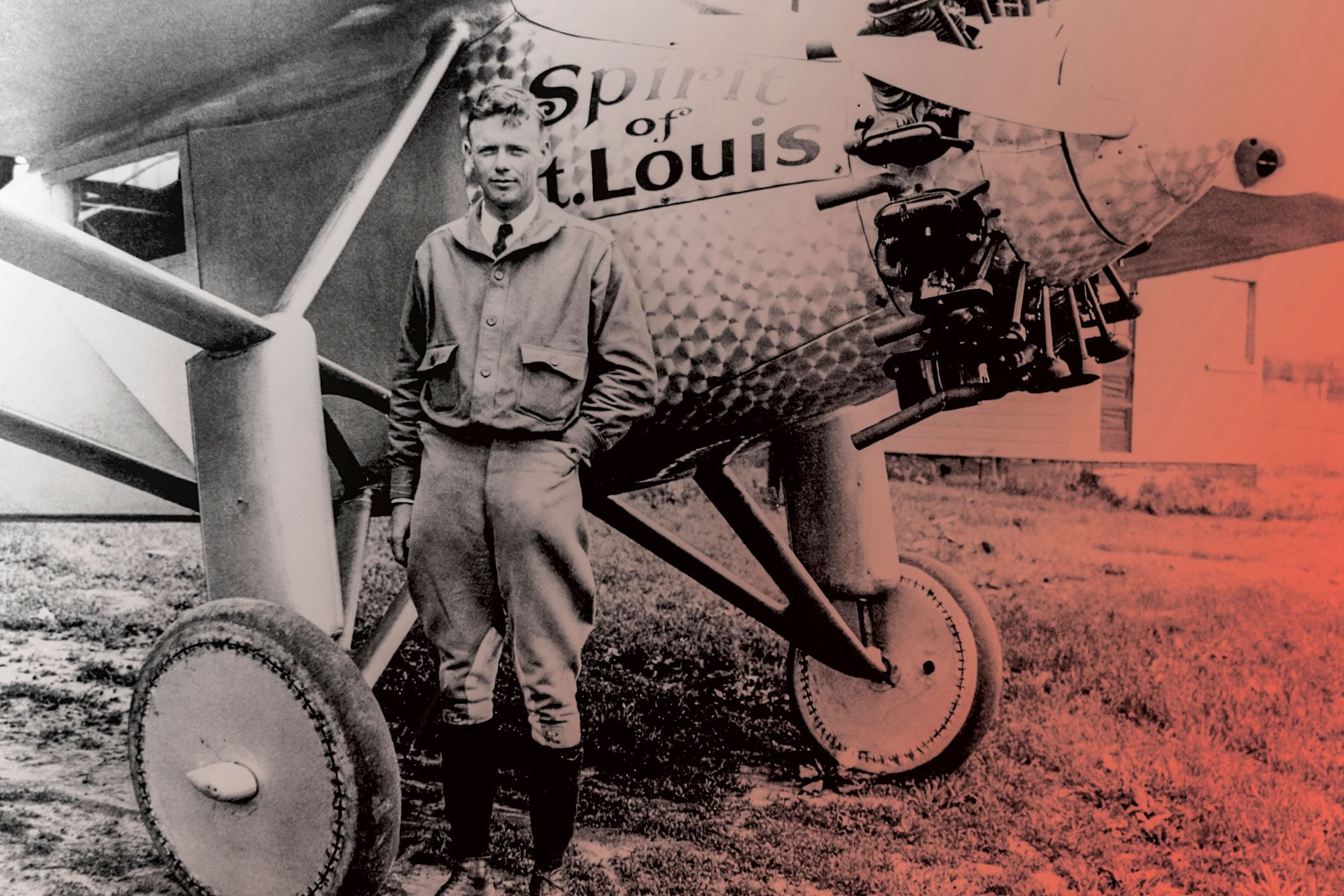 CHARLES LINDBERGH standing in front of the Spirit of St. Louis
