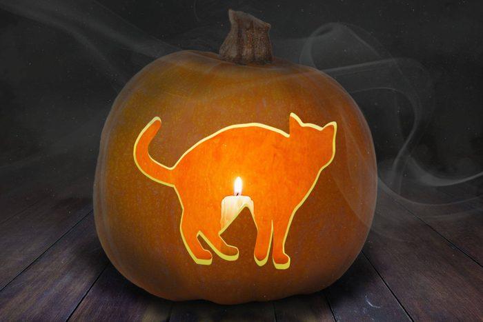 Black Cat carved into Pumpkin