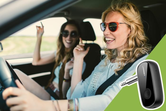 women dancing in car with inset of bluetooth connector