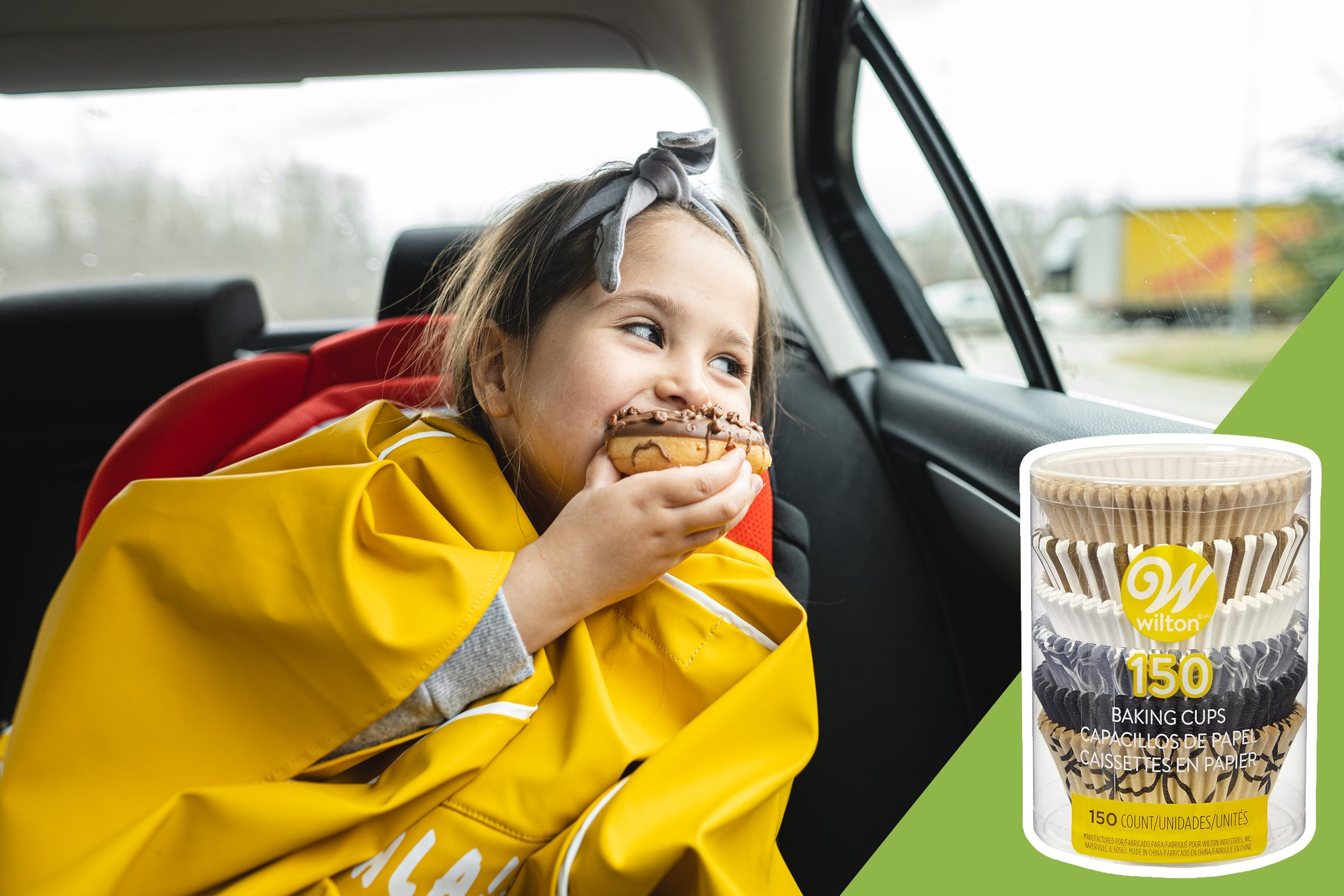 child eating in the backseat of car with inset of cupcake holders