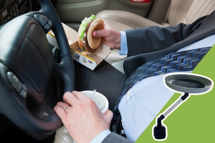 man eating in the car with inset of car tray