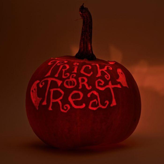 Jack O' Lanterns Halloween Pumpkin that says trick or treat