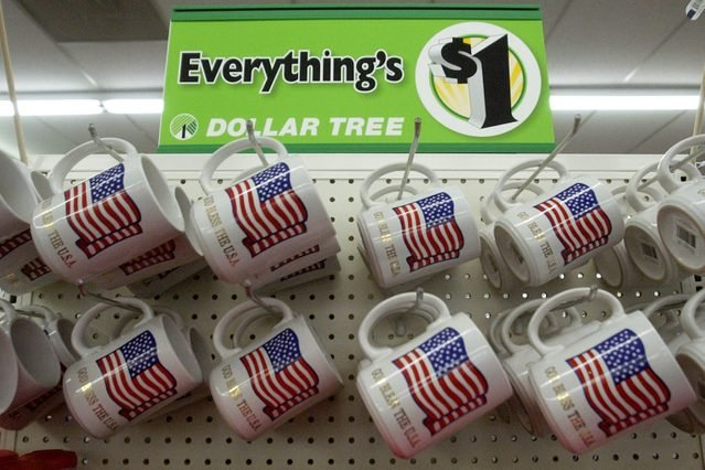 """LITTLETON,COLORADO-May 12, 2004-The Dollar Tree store in Littleton is a popular place to shop. Everything costs $1.00. These $1.00 coffee mugs have an American flag and """"God Bless the USA"""" printed under the flag. (DENVER POST PHOTO BY LYN ALWEIS) 8601 W."""