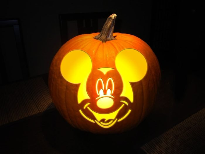 Mickey Mouse carved into a halloween pumpkin