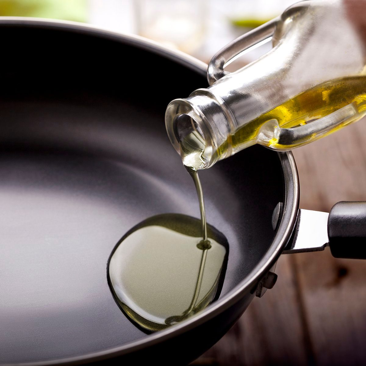 pouring eating oil in frying pan