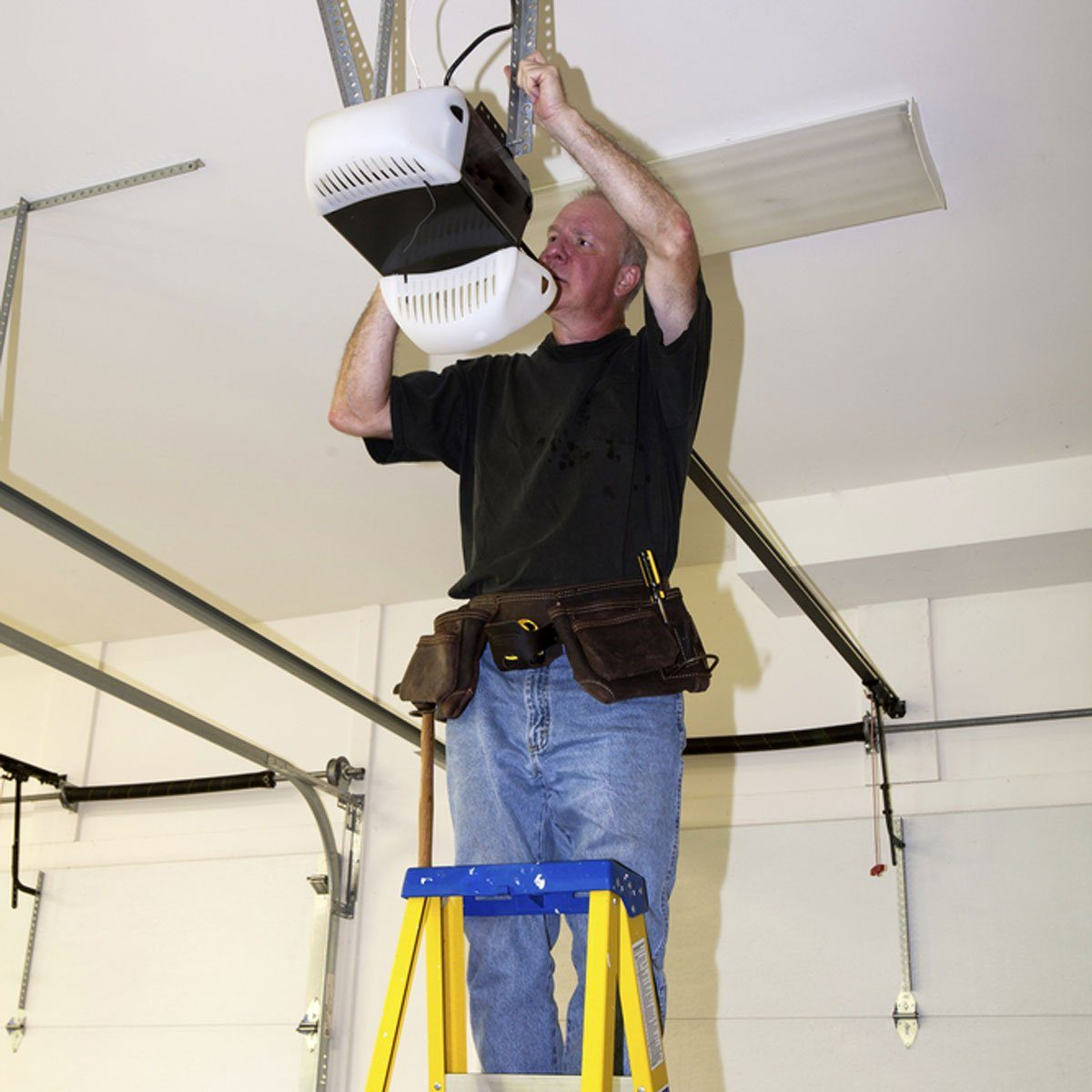 man installing garage door opener