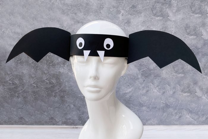 Bat Headband Kids Halloween Craft shown on plastic bust
