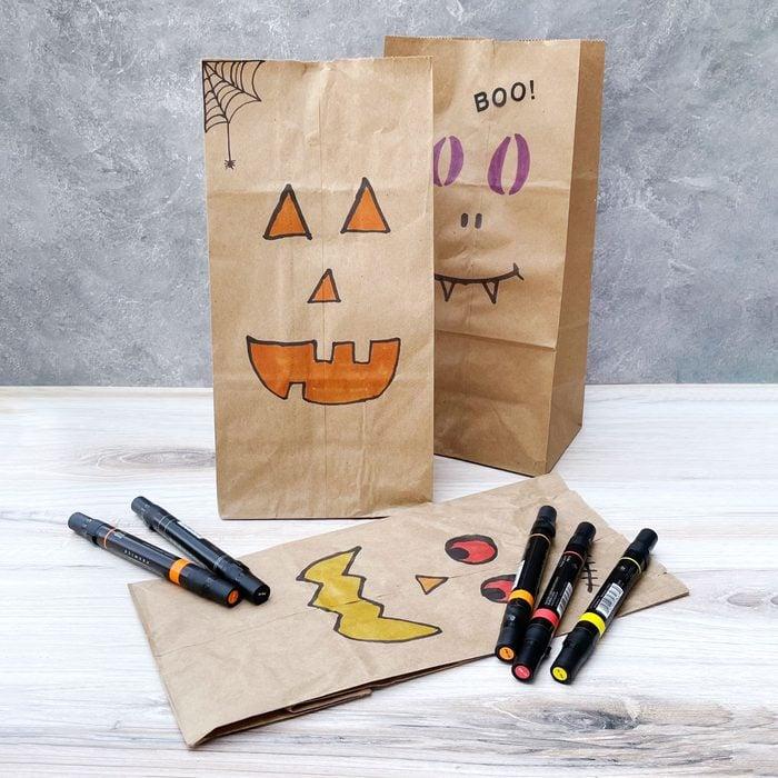 Paper Bag Jack O Lanterns Kids Halloween Craft displayed with markers