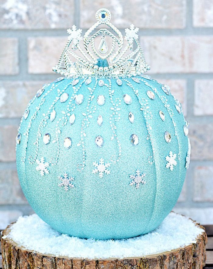 pumpkin decorated with glitter and snowflakes inspired by Elsa from Disneys Frozen