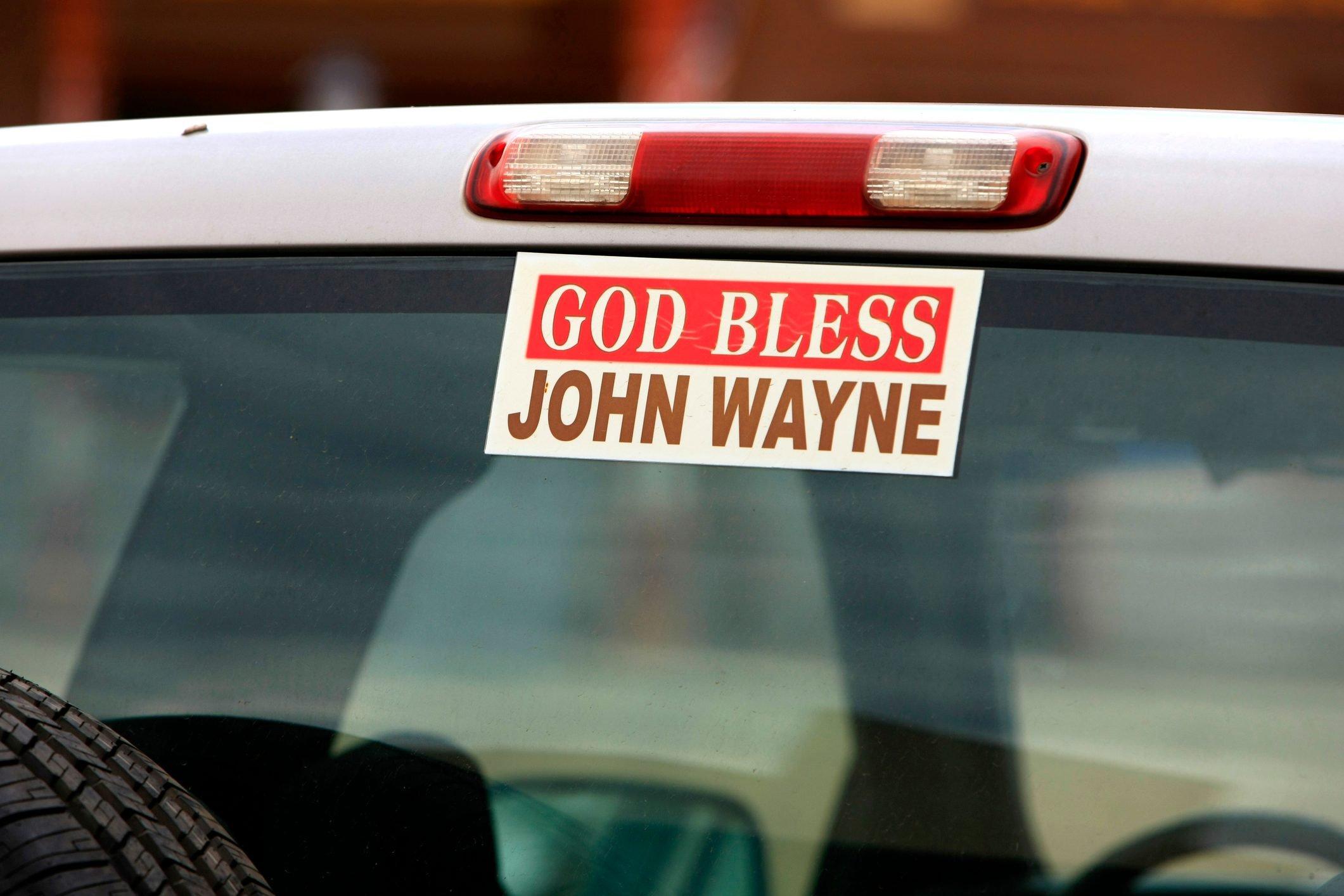 God Bless John Wayne bumper sticker on the rear window of a truck seen in Tombstone, Arizona