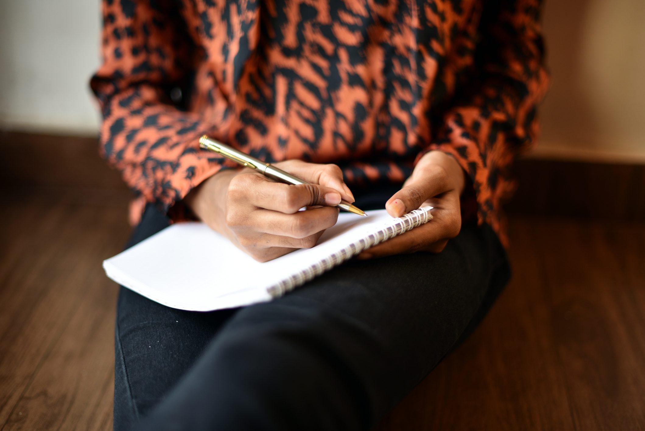 Girl writing on Notepad