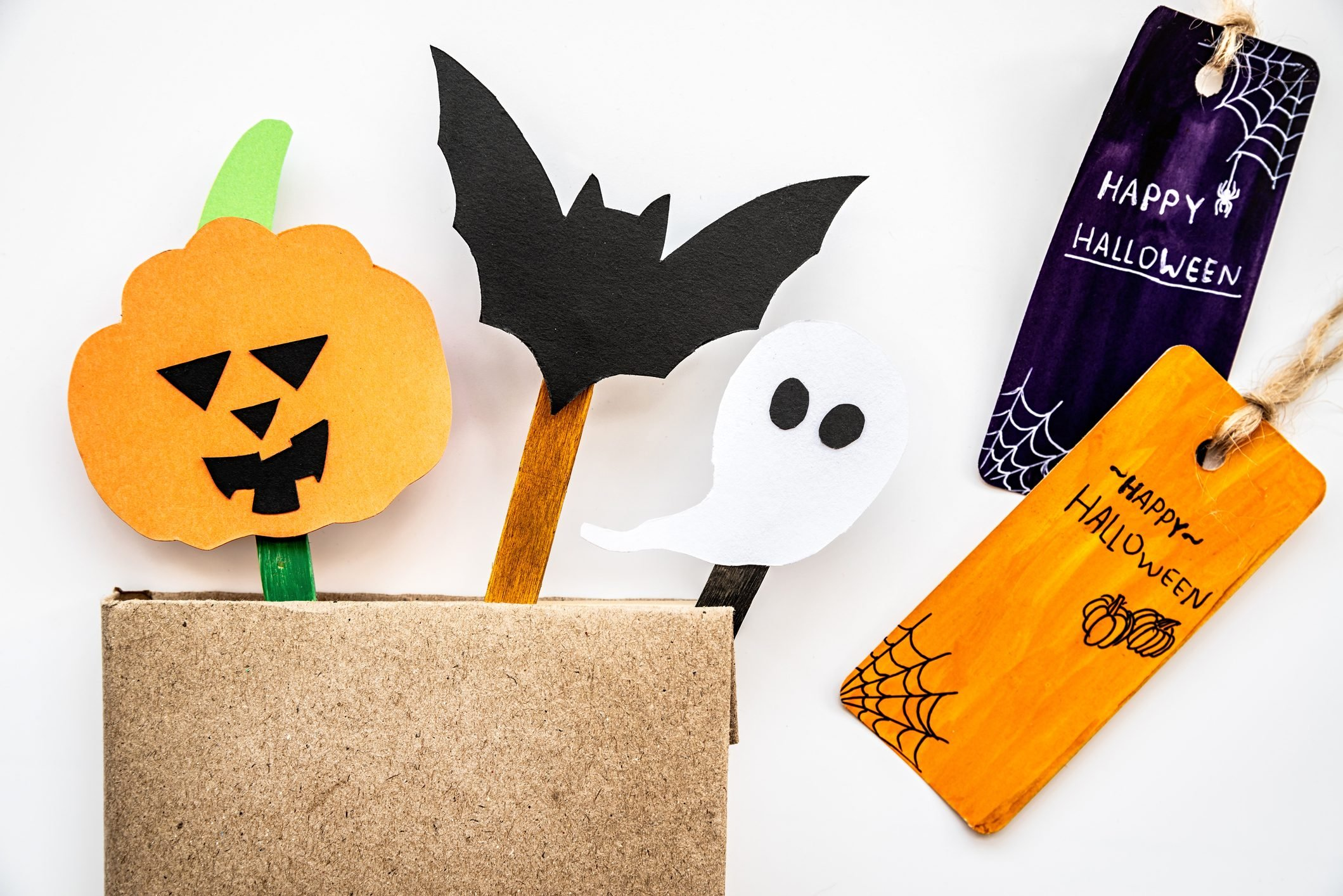 halloween hand made craft bookmars on craft sticks in a book with twopaper tags
