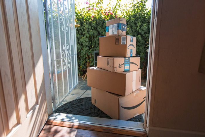 large stack of amazon packages at someones front door