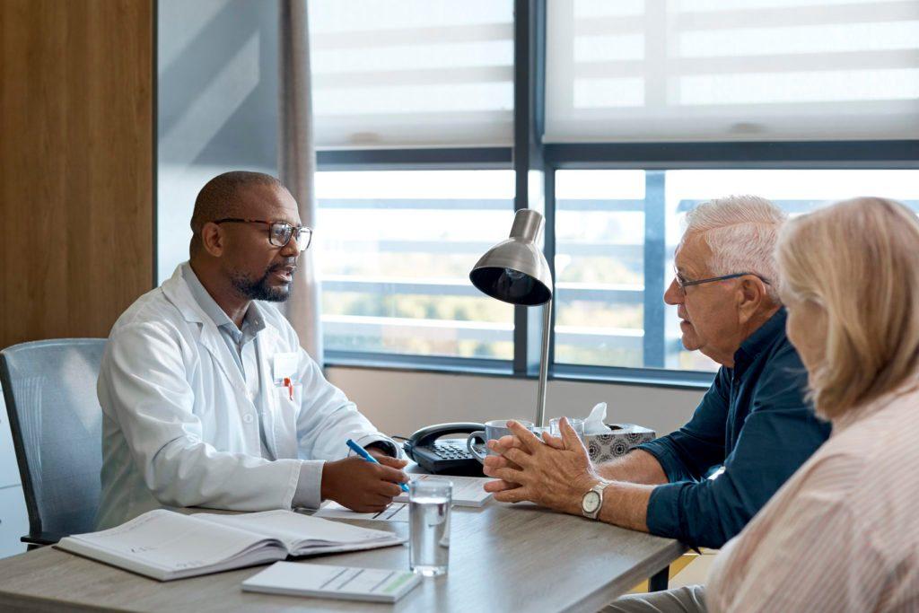 Healthcare worker having meeting with patients
