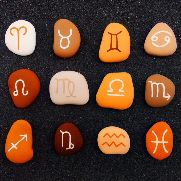 rocks with zodiac symbols