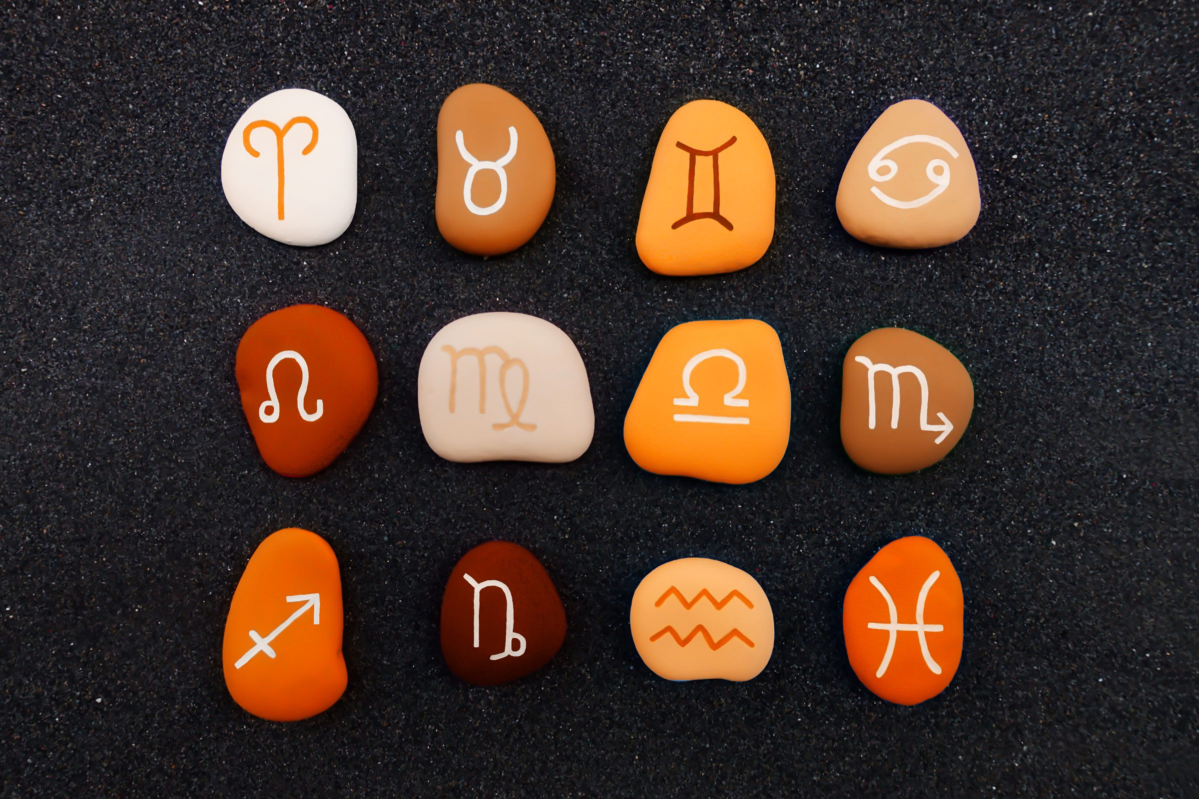 rocks with zodiac symbols