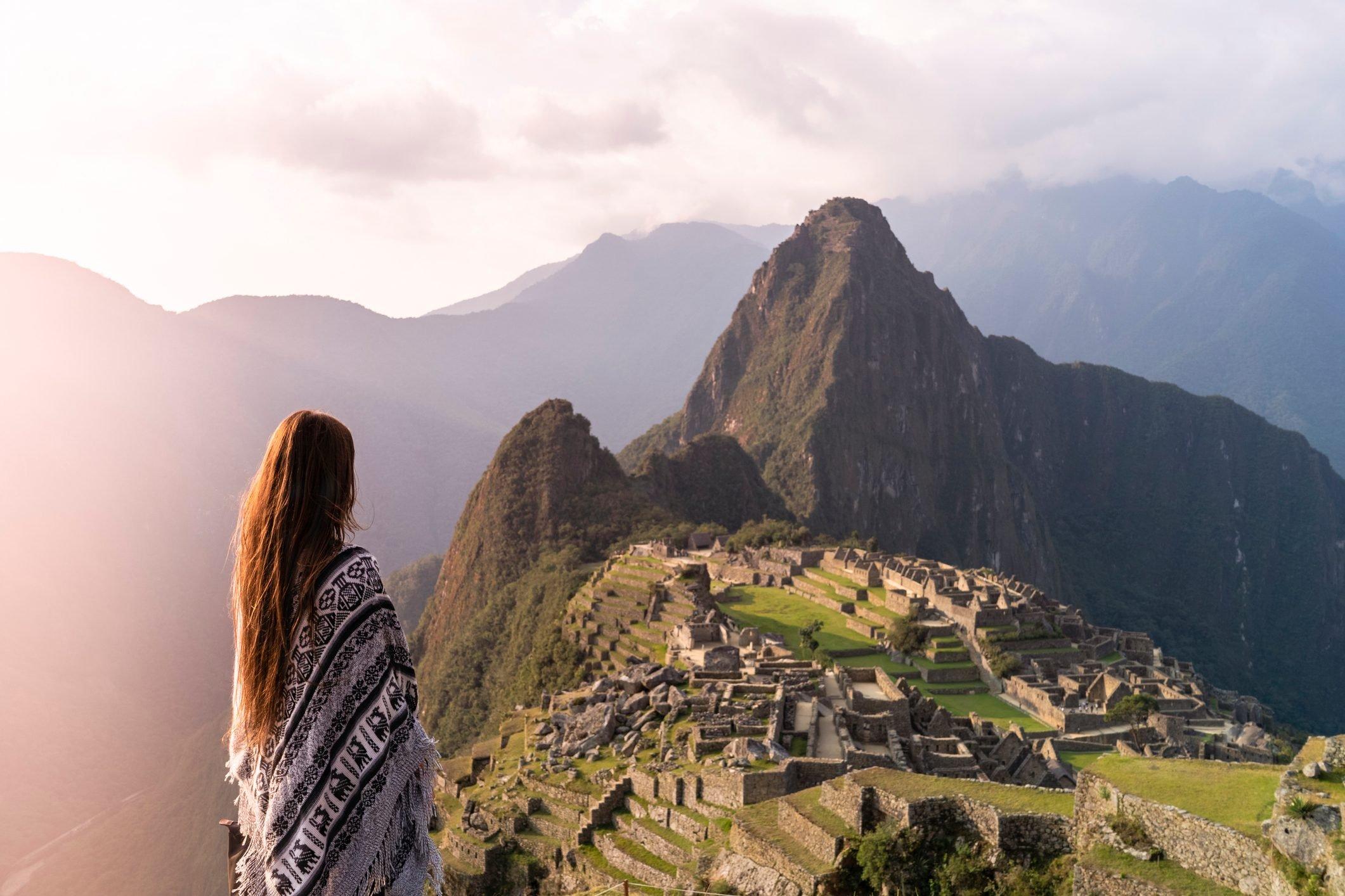 Girl standing in front of Machu Picchu Peru, South America