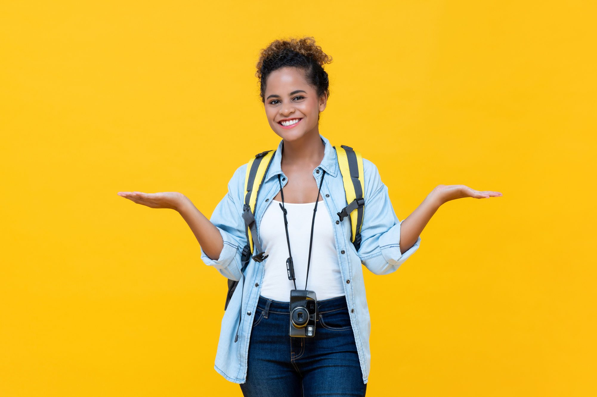 African American woman tourist doing no worry gesture